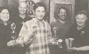 The winners of the darts competition